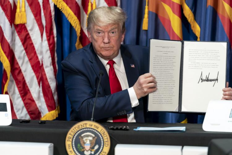 Donald Trump holding the Presidential Proclamation signed on May 5, 2020